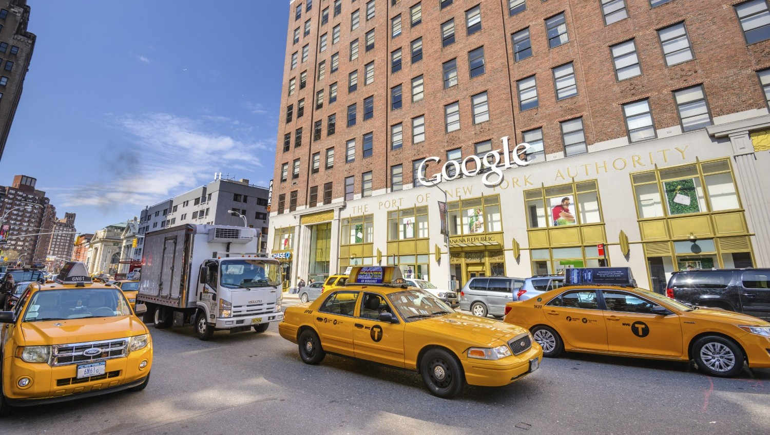 NEW YORK CITY - APRIL 16, 2013: Traffic passes the Google offices. The massive 3 million sq ft former Port Authority building was purchased by Google for 1.9 billion dollars in 2010.
