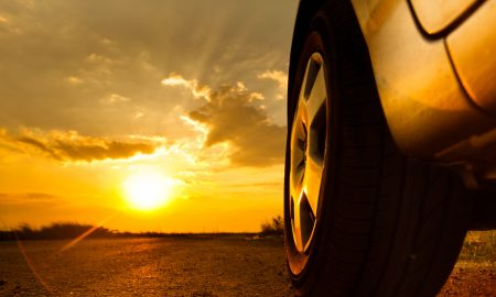 Close up shot of a car against sunset in the background