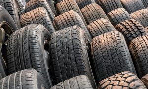Close up stacks of old used tires for saleClose up stacks of old used tires for sale
