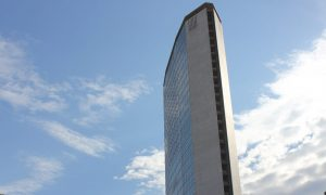 Milan, Italy- May 27, 2014: Pirelly skyscraper building in Milan, architecture in a sunny day with  white clouds
