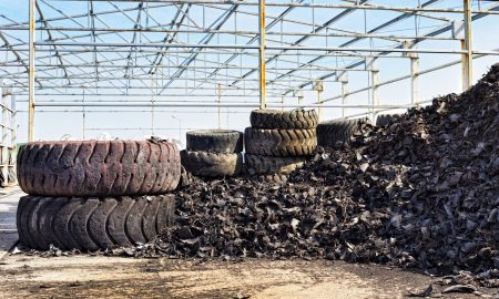 Close up of old used tires and shredded tire pile