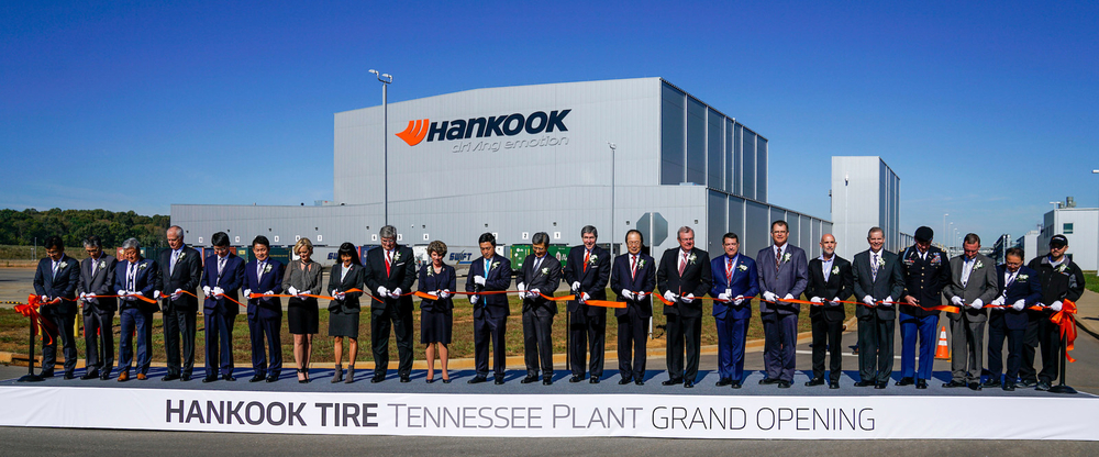Hankook Tire executives and dealers join state and local government officials to celebrate the grand opening of the Tennessee Plant with a ribbon cutting ceremony in Clarksville, Tenn. (PRNewsfoto/Hankook Tire America Corp.)