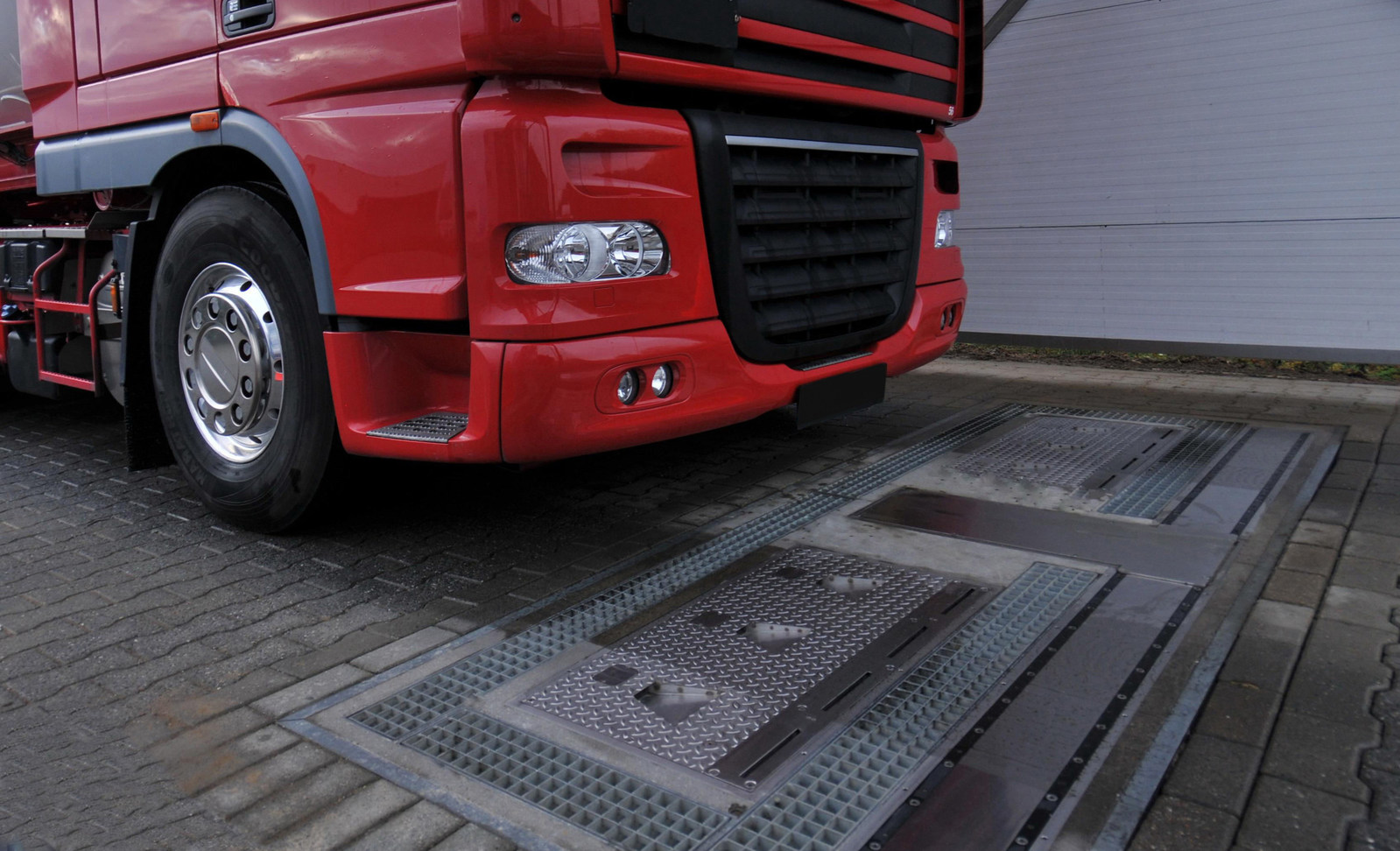 A truck prepares to drive over a fully-automated tire inspection system made by Ventech Systems GmbH. The innovative device can quickly and easily check tire pressure, tread depth and vehicle weight. The Goodyear Tire & Rubber Company has agreed to acquire Ventech Systems of Dorsten, Germany, from Grenzebach Maschinenbau GmbH. (PRNewsfoto/The Goodyear Tire & Rubber Comp)