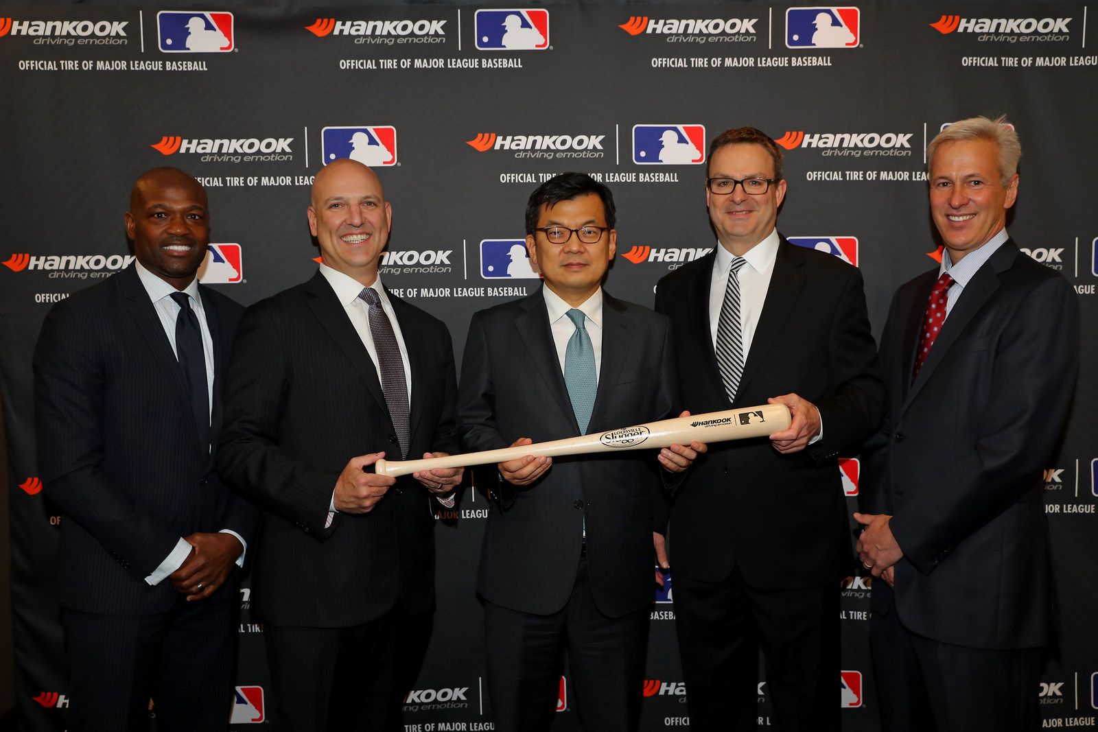 Hankook Tire and Major League Baseball (MLB) announced a new multi-year sponsorship that names Hankook Tire the Official Tire of MLB. L-R: MLB Network Analyst Harold Reynolds, MLB Executive Vice President of Commerce Noah Garden, President of Hankook Tire America Corp. Hosung Suh, Senior Sales Director of Hankook Tire America Corp. Jim Sicking, and MLB Senior Vice President of Sponsorship Sales Bill Morningstar. (PRNewsfoto/Hankook Tire America Corp.)